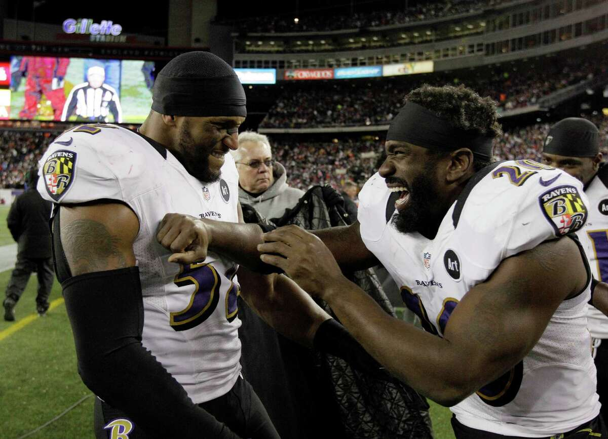 Baltimore Ravens inside linebacker Ray Lewis (52) and free safety Ed Reed (20) celebrate after their win against the New England Patriots in the NFL football AFC Championship football game in Foxborough, Mass., Sunday, Jan. 20, 2013. The Ravens won 28-13 to advance to Super Bowl XLVII. (AP Photo/Matt Slocum)