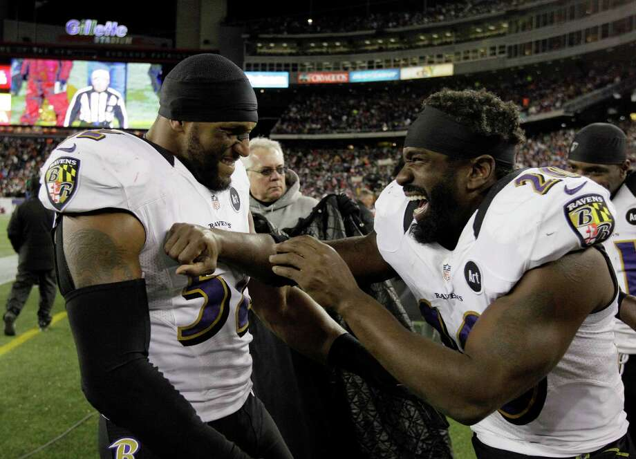 Baltimore Ravens inside linebacker Ray Lewis (52) and free safety Ed Reed (20) celebrate after their win against the New England Patriots in the NFL football AFC Championship football game in Foxborough, Mass., Sunday, Jan. 20, 2013.  The Ravens won 28-13 to advance to Super Bowl XLVII. (AP Photo/Matt Slocum) Photo: Matt Slocum, Associated Press / AP