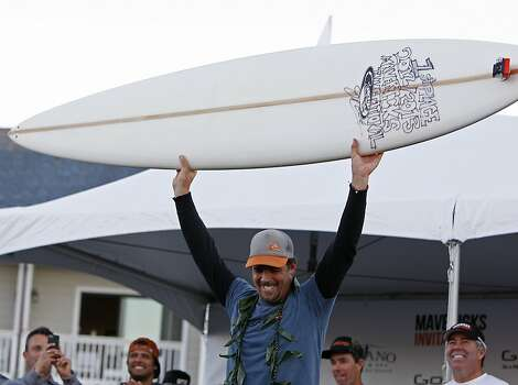 Peter Mel holds up his Jeff Clark surfboard trophy after winning Mavericks Surf Competition on January 20, 2013 in Half Moon Bay, Calif. Photo: Sean Havey, The Chronicle
