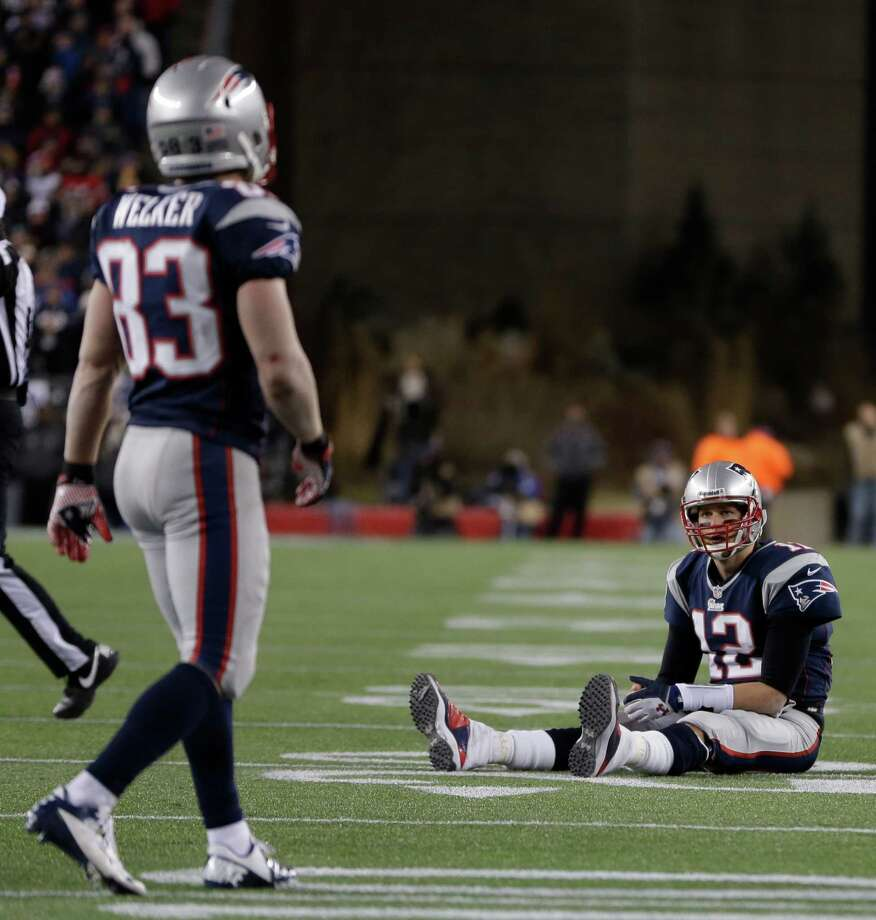 New England Patriots quarterback Tom Brady  sits on the field after getting hit during the second half of the NFL football AFC Championship football game against the Baltimore Ravens in Foxborough, Mass., Sunday, Jan. 20, 2013. (AP Photo/Steven Senne) Photo: Steven Senne, Associated Press / AP