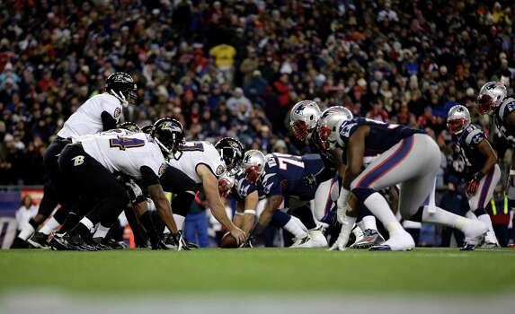 Quarterback Joe Flacco, left, and the Baltimore Ravens line up against the New England Patriots during the first half of the NFL football AFC Championship football game in Foxborough, Mass., Sunday, Jan. 20, 2013. (AP Photo/Matt Slocum) Photo: Matt Slocum, Associated Press / AP