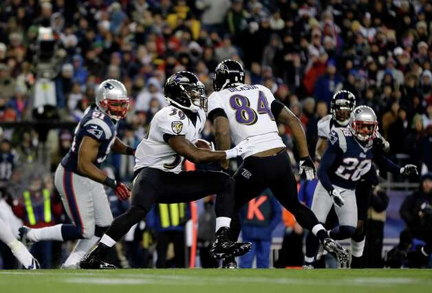 Baltimore Ravens running back Bernard Pierce (30) runs past tight end Ed Dickson (84) during the first half of the NFL football AFC Championship football game against the New England Patriots in Foxborough, Mass., Sunday, Jan. 20, 2013. (AP Photo/Matt Slocum) Photo: Matt Slocum, Associated Press / AP