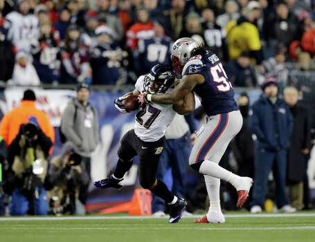 New England Patriots middle linebacker Brandon Spikes (55) tackles Baltimore Ravens running back Ray Rice (27) during the first half of the NFL football AFC Championship football game in Foxborough, Mass., Sunday, Jan. 20, 2013. (AP Photo/Matt Slocum) Photo: Matt Slocum, Associated Press / AP