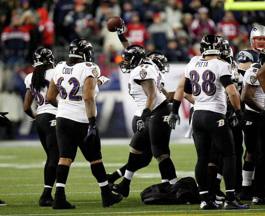 Baltimore Ravens defensive end Arthur Jones, center, celebrates his fumble recovery against the New England Patriots during the second half of the NFL football AFC Championship football game in Foxborough, Mass., Sunday, Jan. 20, 2013. (AP Photo/Stephan Savoia) Photo: Stephan Savoia, Associated Press / AP