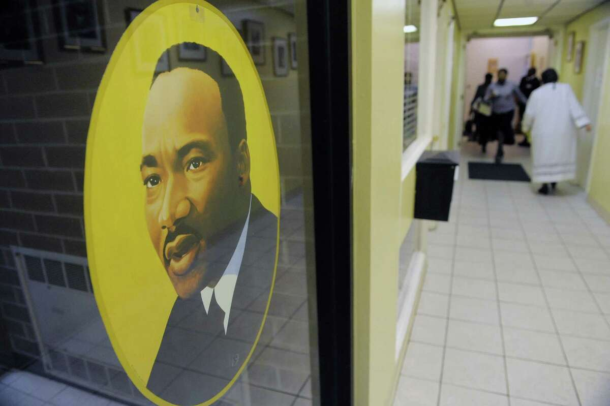 A large portrait of the Rev. Dr. Martin Luther king, Jr. is posted near the entrance during an interfaith worship service at Bethel Baptist Church to celebrate the Rev. Dr. Martin Luther king, Jr. on Sunday, Jan. 20, 2013 in Troy, NY. The offering at the service raised money for the Rev. Dr. Martin Luther king, Jr. Scholarship Fund for Troy area youth or adults who wish to pursue advanced education. Over $1,800 was raised through the offering. (Paul Buckowski / Times Union)