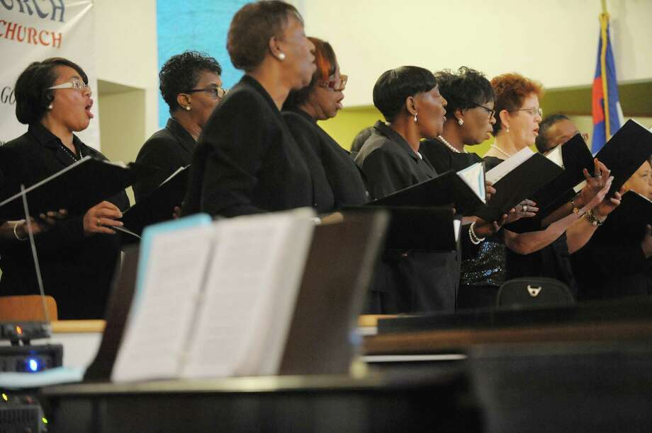 Members of the MLK Combined Choir sing  during an interfaith worship service at Bethel Baptist Church to celebrate the Rev. Dr. Martin Luther king, Jr. on Sunday, Jan. 20, 2013 in Troy, NY.  The offering at the service raised money for the Rev. Dr. Martin Luther king, Jr. Scholarship Fund for Troy area youth or adults who wish to pursue advanced education.  Over $1,800 was raised through the offering. (Paul Buckowski / Times Union) Photo: Paul Buckowski