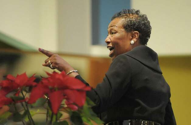Pamela Sharpe, music director of the MLK Combined Choir directs the choir as they perform at an interfaith worship service at Bethel Baptist Church to celebrate the Rev. Dr. Martin Luther king, Jr. on Sunday, Jan. 20, 2013 in Troy, NY.  The offering at the service raised money for the Rev. Dr. Martin Luther king, Jr. Scholarship Fund for Troy area youth or adults who wish to pursue advanced education.  Over $1,800 was raised through the offering. (Paul Buckowski / Times Union) Photo: Paul Buckowski