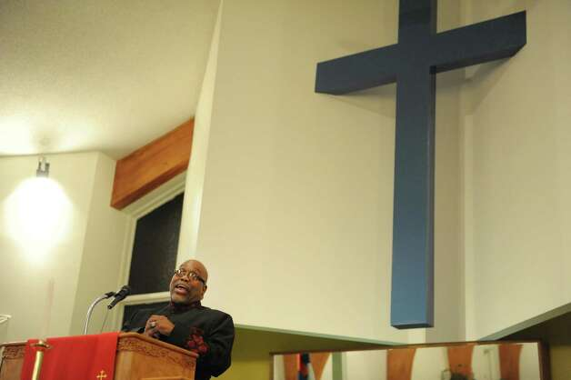 The Rev. Elgin Joseph Taylor, Sr., pastor of Sweet Pilgrim Missionary Baptist Church,  preaches  during an interfaith worship service at Bethel Baptist Church to celebrate the Rev. Dr. Martin Luther king, Jr. on Sunday, Jan. 20, 2013 in Troy, NY.  The offering at the service raised money for the Rev. Dr. Martin Luther king, Jr. Scholarship Fund for Troy area youth or adults who wish to pursue advanced education.  Over $1,800 was raised through the offering. (Paul Buckowski / Times Union) Photo: Paul Buckowski