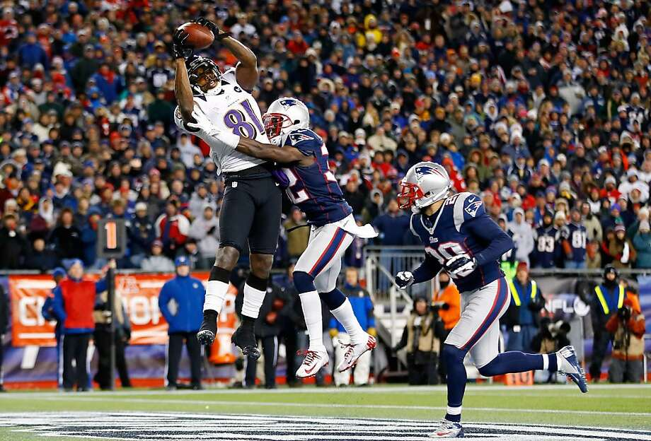 Baltimore receiver Anquan Boldin outleaps Devin McCourty of the Patriots to catch one of his two fourth-quarter touchdown passes from Joe Flacco. Photo: Jared Wickerham, Getty Images