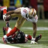 Wide receiver Michael Crabtree (15) runs over Falcons cornerback Asante Samuel (22) during the first half of the San Francisco 49ers game against the Atlanta Falcons in the NFC Championship game at the Georgia Dome in Atlanta, GA., on Sunday January 20, 2013.