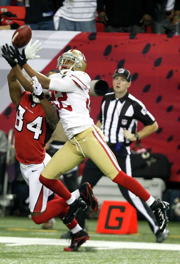 Cornerback Carlos Rogers (22) blocks a pass intended for wide receiver Roddy White (84) during the San Francisco 49ers game against the Atlanta Falcons in the NFC Championship game at the Georgia Dome in Atlanta, GA., on Sunday January 20, 2013. Photo: Michael Macor / The Chronicle / ONLINE_YES