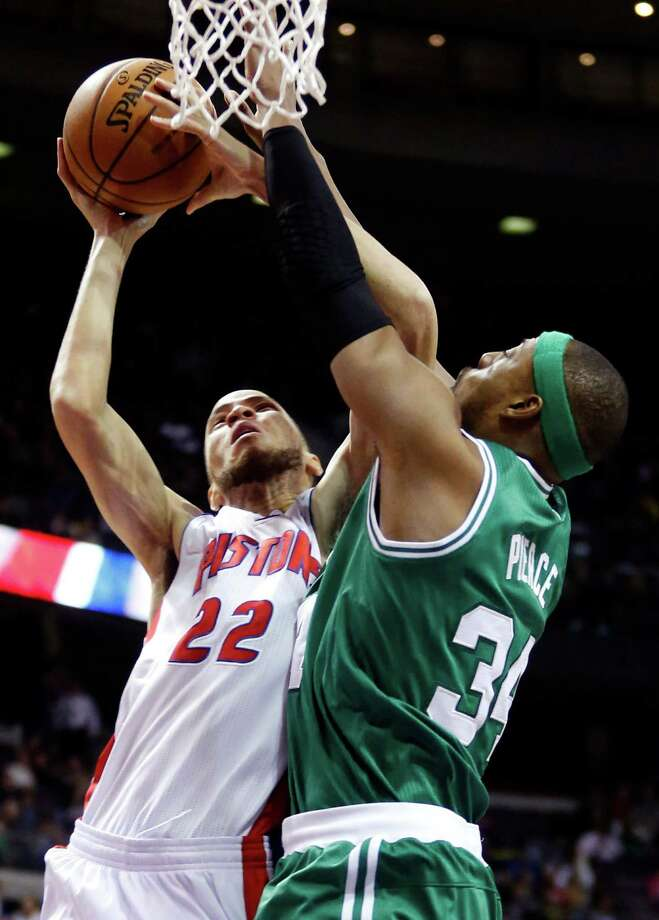 Boston Celtics forward Paul Pierce (34) defends against Detroit Pistons forward Tayshaun Prince (22) in the first half of an NBA basketball game, Sunday, Jan. 20, 2013, in Auburn Hills, Mich. (AP Photo/Duane Burleson) Photo: Duane Burleson