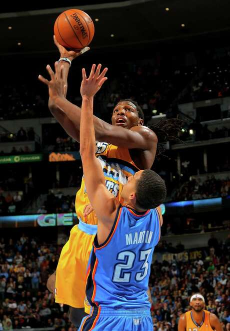 The Nuggets' Kenneth Faried found his shot when it mattered most. Photo: Doug Pensinger, Staff / 2013 Getty Images