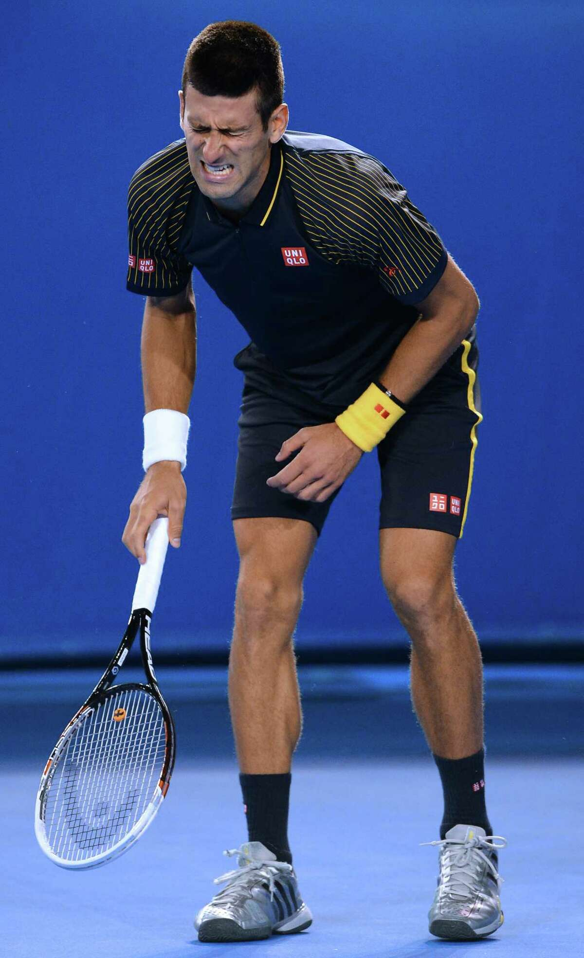 Novak Djokovic shows the strain of playing 5 hours and 2 minutes and winning.