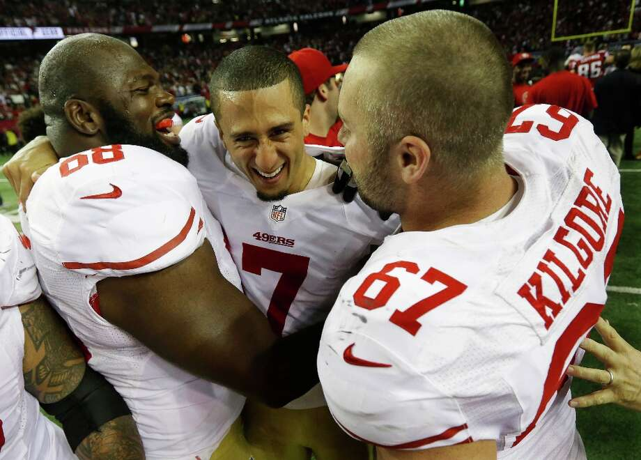 San Francisco 49ers' Colin Kaepernick (7) celebrates with Leonard Davis and Daniel Kilgore (67) after the NFL football NFC Championship game against the Atlanta Falcons Sunday, Jan. 20, 2013, in Atlanta. The 49ers won 28-24 to advance to Superbowl XLVII. Photo: Dave Martin, Associated Press / AP