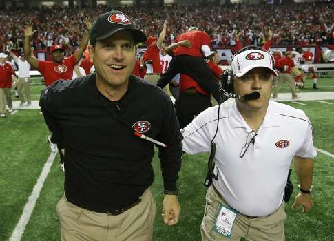 San Francisco 49ers head coach Jim Harbaugh runs onto the field with an assistant after the NFL football NFC Championship game against the Atlanta Falcons Sunday, Jan. 20, 2013, in Atlanta. The 49ers won 28-24 to advance to Superbowl XLVII. Photo: Dave Martin, Associated Press / AP