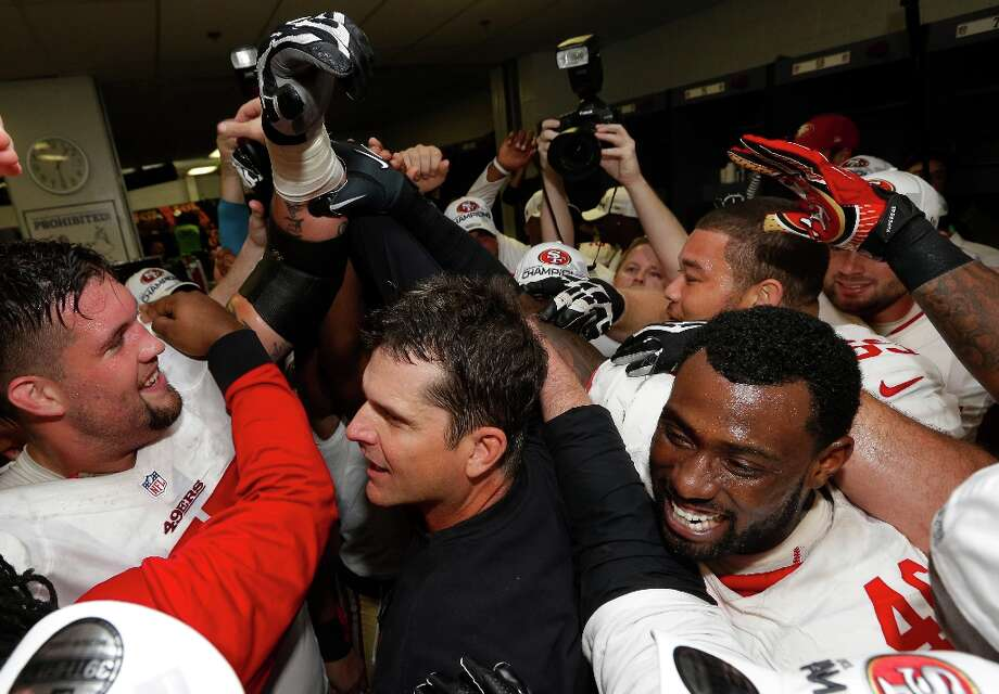 The San Francisco 49ers celebrate with head coach Jim Harbaugh, center, after the NFL football NFC Championship game against the Atlanta Falcons Sunday, Jan. 20, 2013, in Atlanta. The 49ers won 28-24 to advance to Super Bowl XLVII. Photo: Dave Martin, Associated Press / AP