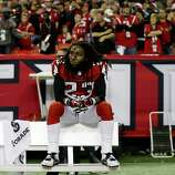 Atlanta Falcons' Dunta Robinson sits on the team bench after being defeated by San Francisco 49ers in the NFL football NFC Championship game Sunday, Jan. 20, 2013, in Atlanta. The 49ers won 28-24 to advance to Superbowl XLVII.