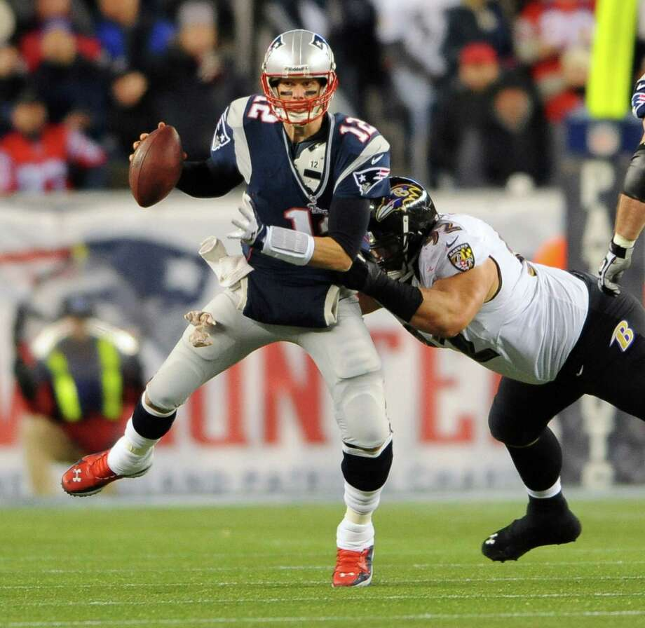 Patriots quarterback Tom Brady, pressured here by Haloti Ngata, didn't produce any second-half points. Photo: Kenneth K. Lam, MBR / Baltimore Sun