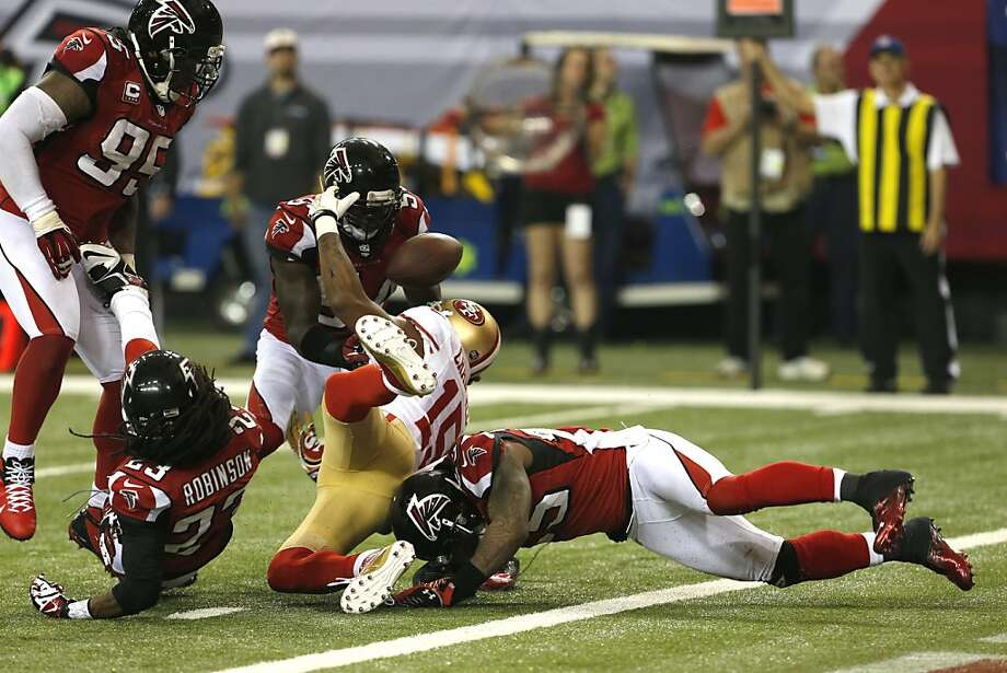 Wide receiver Michael Crabtree (15) fumbles the ball on the one yard line during fourth quarter of the San Francisco 49ers game against the Atlanta Falcons in the NFC Championship game at the Georgia Dome in Atlanta, GA., on Sunday January 20, 2013. Photo: Carlos Avila Gonzalez, The Chronicle