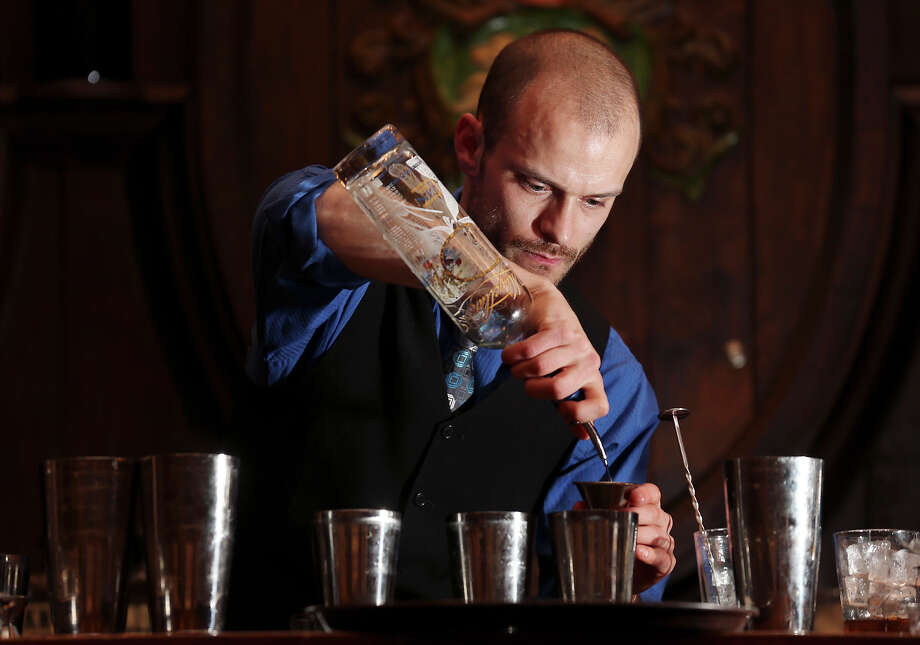 Brooklynite bartender Rob Gourlay prepares cocktails during the Sasha Petraske's Skills Competition part of the San Antonio Cocktail Conference Saturday Jan. 19, 2013 at the St. Anthony Hotel. Photo: Edward A. Ornelas, San Antonio Express-News / © 2012 San Antonio Express-News