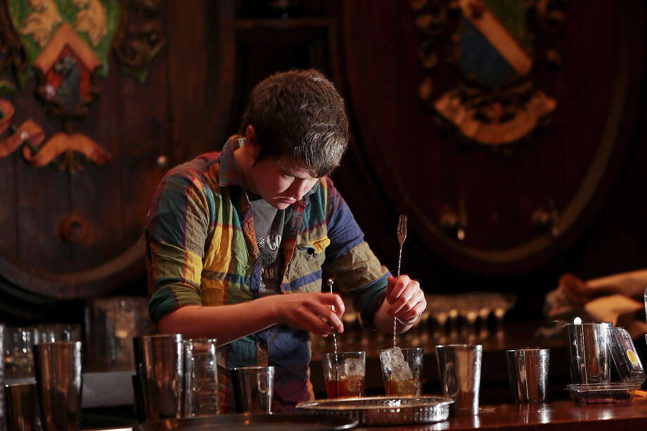 Esquire bar manager Karah Carmack prepares cocktails during the Sasha Petraske's Skills Competition part of the San Antonio Cocktail Conference Saturday Jan. 19, 2013 at the St. Anthony Hotel. Photo: Edward A. Ornelas, San Antonio Express-News / © 2012 San Antonio Express-News