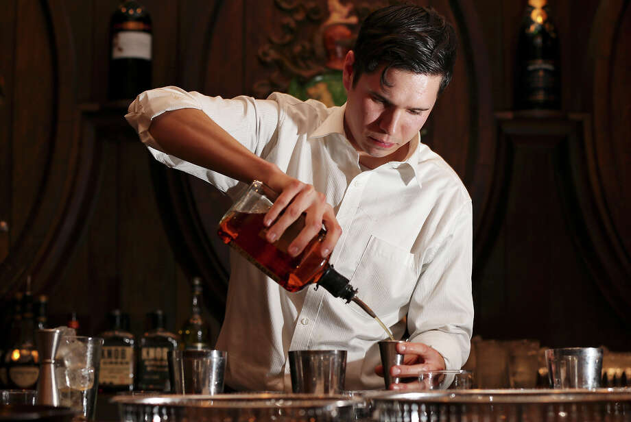 Bohanan's bar head bartender Jake Corney prepares cocktails during the Sasha Petraske's Skills Competition part of the San Antonio Cocktail Conference Saturday Jan. 19, 2013 at the St. Anthony Hotel. Photo: Edward A. Ornelas, San Antonio Express-News / © 2012 San Antonio Express-News