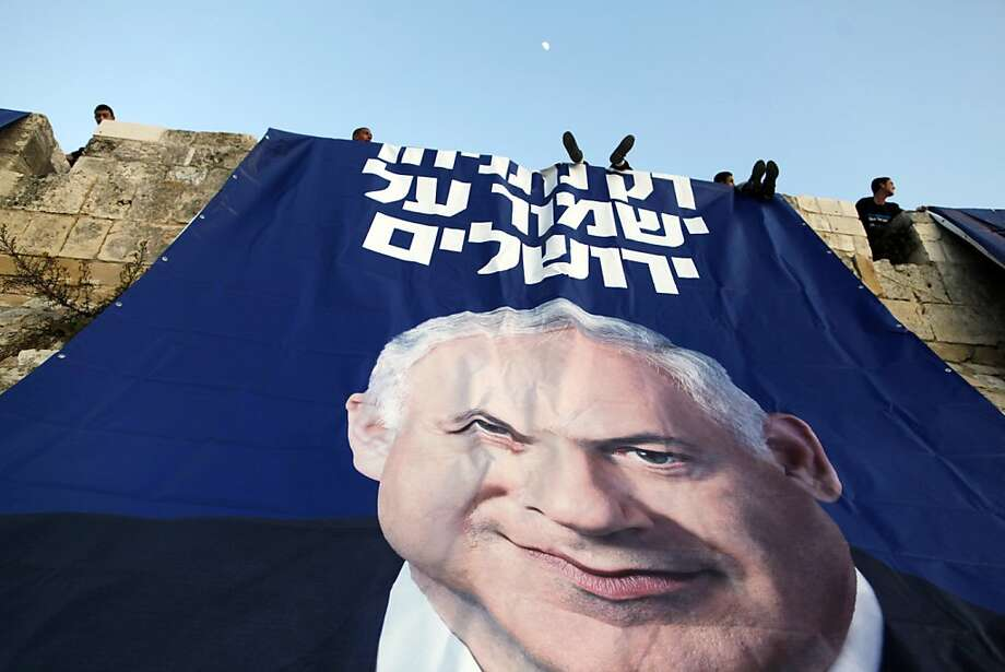 "Likud party activists hang campaign posters of Israeli Prime Minister Benjamin Netanyahu that read in Hebrew "" Only Netanyahu will guard Jerusalem""  under David's Citadel at Jaffa Gate in the Old city on January 20, 2013 in Jerusalem, Israel. The Israeli general election will be held on January 22. Photo: Lior Mizrahi, Getty Images"