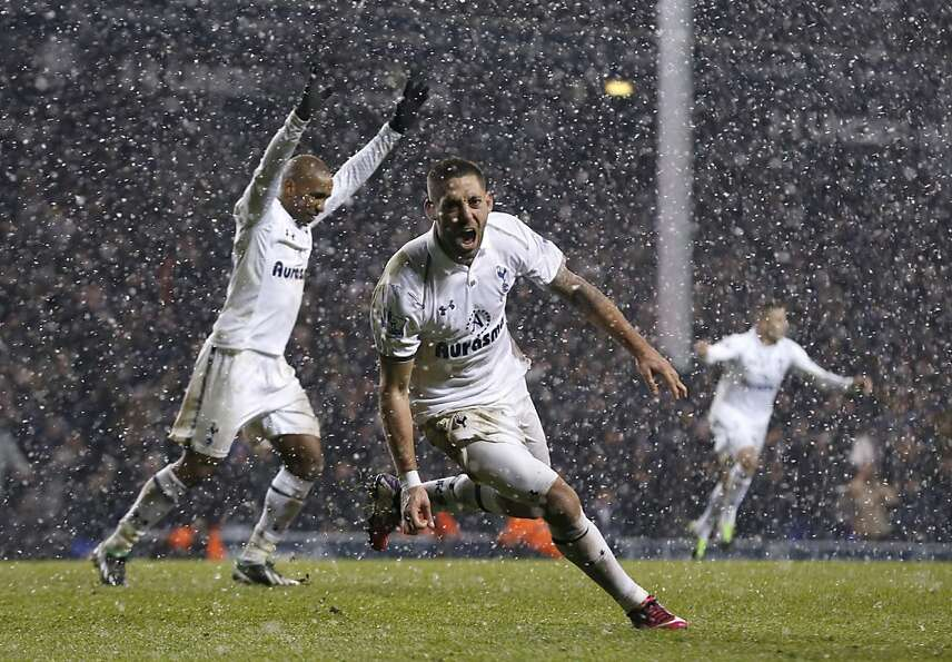 Tottenham Hotspur's Clint Dempsey, center, celebrates his goal beside Jermain Defoe, left, during th