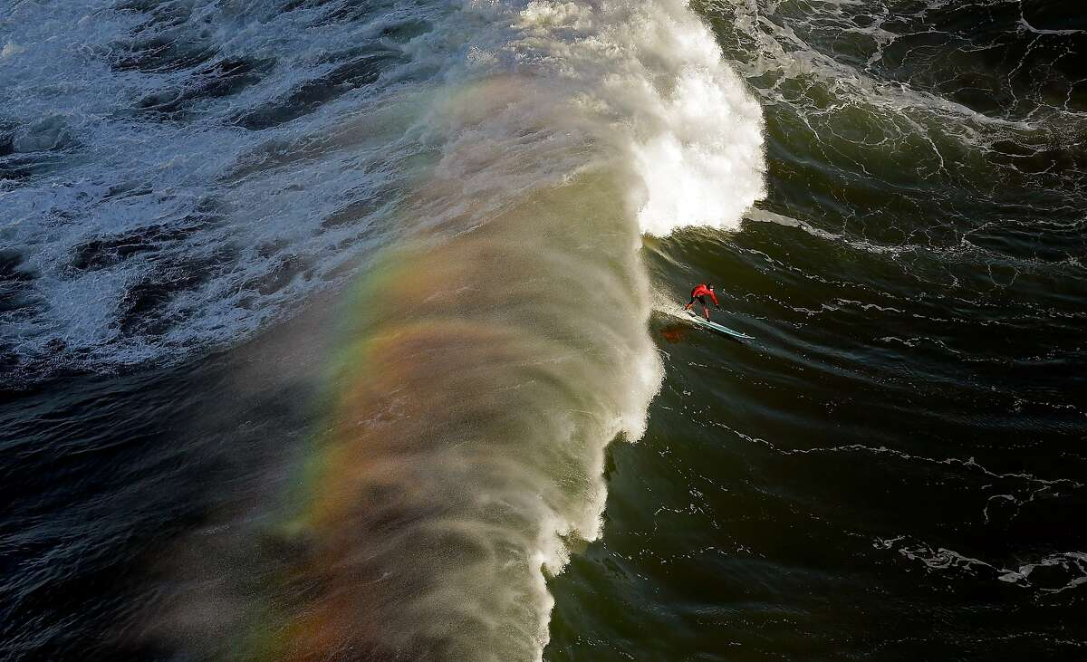 HALF MOON BAY, CA - JANUARY 20: Peter Mel competes during the first heat of the Maverick's Invitational surf competition on January 20, 2013 in Half Moon Bay, California. Mel went on to win the event. (Photo by Ezra Shaw/Getty Images)