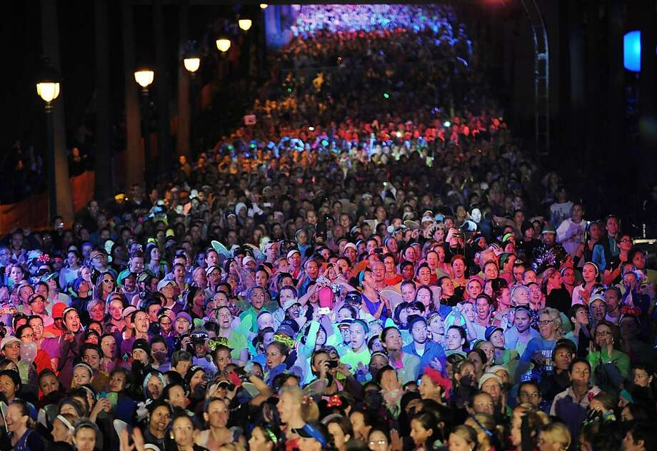 Athletes gather to run in the annual Tinker Bell half marathon Sunday, Jan. 20, 2013, in Anaheim, Calif. The 13.1 mile run snakes through Disney parks in Anaheim and surrounding streets. Photo: Mindy Schauer, Associated Press
