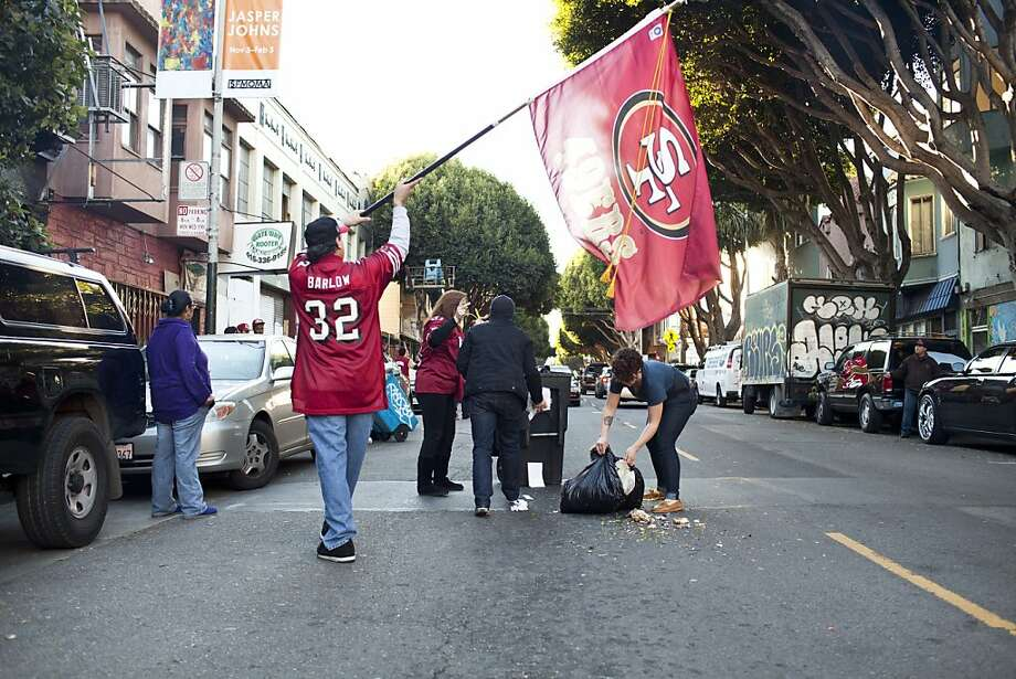 A Niner's fan pushed a trash can onto 24th Street and was promptly arrested by SFPD during celebrations and residents helped clean it up after the San Francisco 49er's beat the Atlanta Falcons in San Francisco, Calif., Sunday, January, 20, 2013. Photo: Jason Henry, Special To The Chronicle