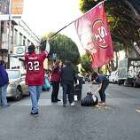 A Niner's fan pushed a trash can onto 24th Street and was promptly arrested by SFPD during celebrations and residents helped clean it up after the San Francisco 49er's beat the Atlanta Falcons in San Francisco, Calif., Sunday, January, 20, 2013.