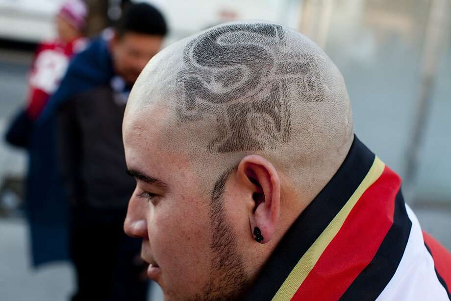 Francisco Duartez shaved the 49ers logo onto the side of his head as he celebrated along 24th Street after the San Francisco 49er's beat the Atlanta Falcons in San Francisco, Calif., Sunday, January, 20, 2013. Photo: Jason Henry, Special To The Chronicle
