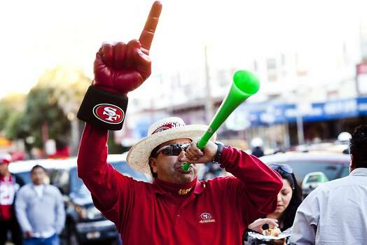 Ben Mosqueda played a vuvuzela along Mission Street after the San Francisco 49er's beat the Atlanta Falcons in San Francisco, Calif., Sunday, January, 20, 2013. Photo: Jason Henry, Special To The Chronicle