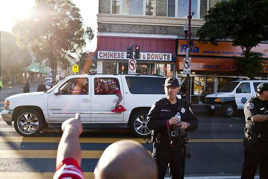 Niners fans celebrated at 24th and Mission Streets after the San Francisco 49er's beat the Atlanta Falcons in San Francisco, Calif., Sunday, January, 20, 2013. Photo: Jason Henry, Special To The Chronicle