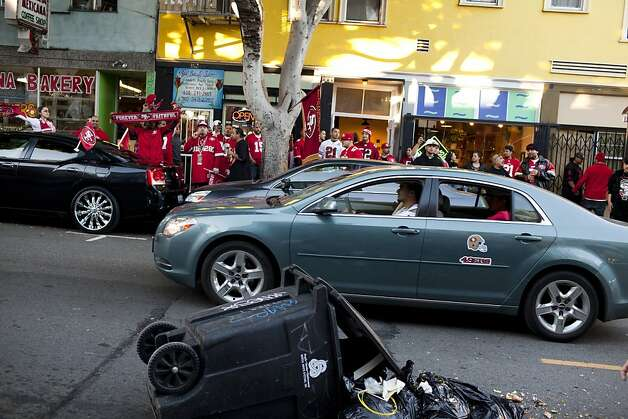 A Niners fan pushed a trash can onto 24th Street during celebrations after the San Francisco 49ers beat the Atlanta Falcons, and was promptly arrested by SFPD in San Francisco on Sunday, Jan. 20, 2013. Photo: Jason Henry, Special To The Chronicle
