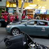 A Niner's fan pushed a trash can onto 24th Street during celebrations after the San Francisco 49er's beat the Atlanta Falcons and was promptly arrested by SFPD in San Francisco, Calif., Sunday, January, 20, 2013.
