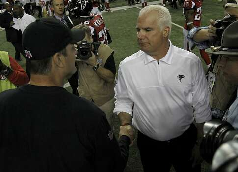 Atlanta coach Mike Smith congratulated Jim Harbaugh on the victory. The San Francisco 49ers beat the Atlanta Falcons 28-24 to win the NFC title and advance to the Super Bowl Sunday January 20, 2013. Photo: Brant Ward, The Chronicle