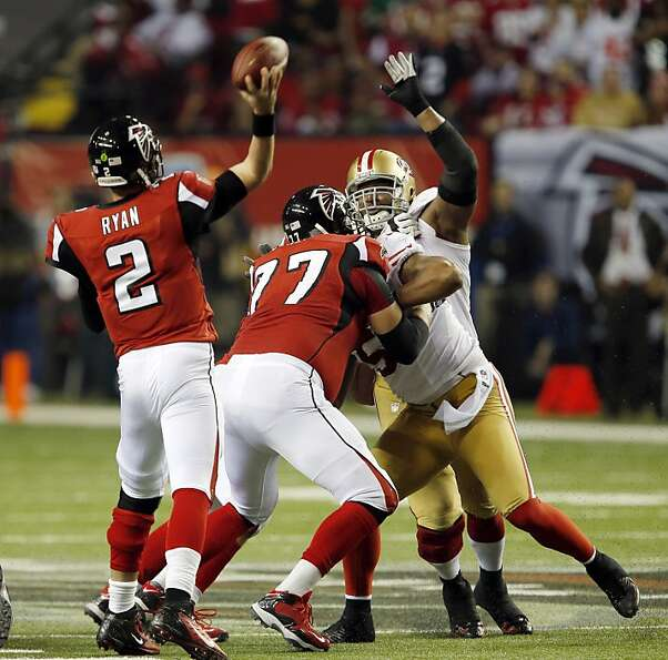 Matt Ryan throws under pressure in the fourth quarter. The San Francisco 49ers played the Atlanta Fa