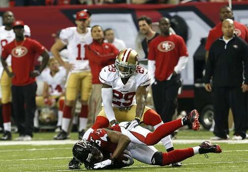 Linebacker Aldon Smith (99) takes down wide receiver Roddy White (84) during the fourth quarter of the San Francisco 49ers game against the Atlanta Falcons in the NFC Championship game at the Georgia Dome in Atlanta, GA., on Sunday January 20, 2013. Photo: Carlos Avila Gonzalez, The Chronicle