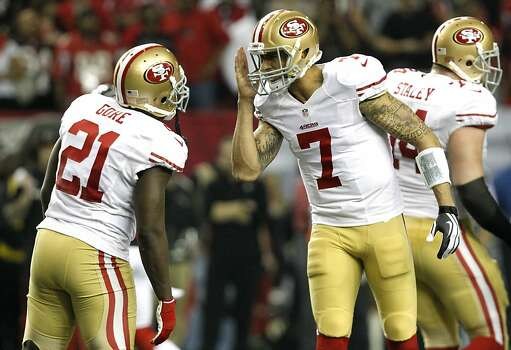 Quarterback Colin Kaepernick (7) talks with Running back Frank Gore (21) about a play prior to the snap late in the fourth quarter of the San Francisco 49ers game against the Atlanta Falcons in the NFC Championship game at the Georgia Dome in Atlanta, GA., on Sunday January 20, 2013. Photo: Michael Macor, The Chronicle