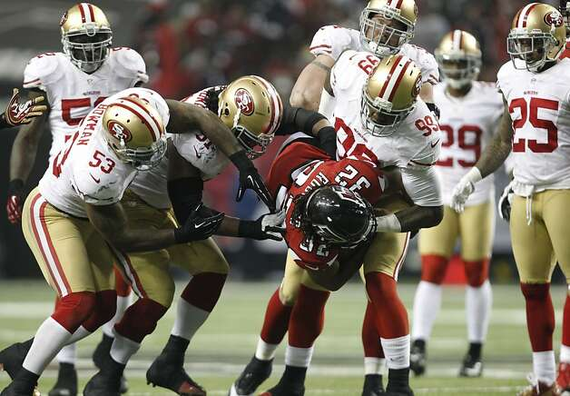 San Francisco 49ers Linebacker Aldon Smith (99), Defensive tackle Ray McDonald (91), Linebacker NaVorro Bowman (53 and Offensive tackle Joe Staley (74) pick up Atlanta Falcons running back Jacquizz Rodgers (32) during the San Francisco 49ers game against the Atlanta Falcons in the NFC Championship game at the Georgia Dome in Atlanta, GA., on Sunday January 20, 2013. Photo: Michael Macor, The Chronicle