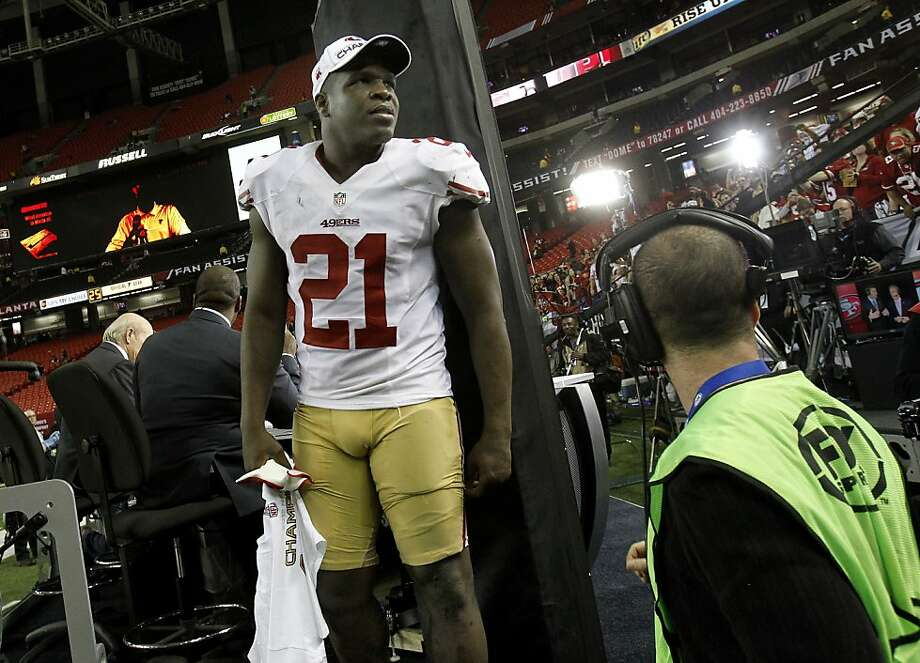 Frank Gore looked at some 49er fans after finishing an interview for television. The San Francisco 49ers beat the Atlanta Falcons 28-24 to win the NFC title and advance to the Super Bowl Sunday January 20, 2013. Photo: Brant Ward, The Chronicle