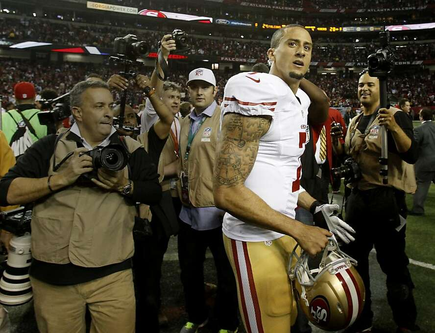 Colin Kaepernick was mobbed by photographers after the contest. The San Francisco 49ers beat the Atlanta Falcons 28-24 to win the NFC title and advance to the Super Bowl Sunday January 20, 2013. Photo: Brant Ward, The Chronicle