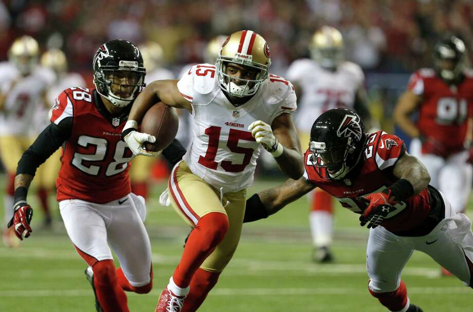 Wide receiver Michael Crabtree (15) runs past Running back Rock Cartwright (28) and snapper Charles Mitchell (26)during the second half of the San Francisco 49ers game against the Atlanta Falcons in the NFC Championship game at the Georgia Dome in Atlanta, GA., on Sunday January 20, 2013. Photo: Carlos Avila Gonzalez / The Chronicle / ONLINE_YES