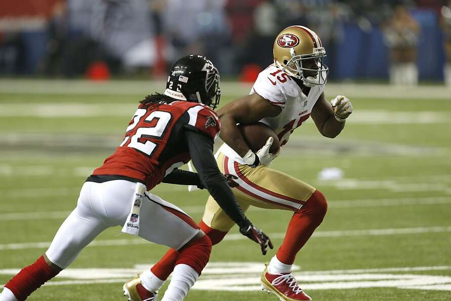 Wide receiver Michael Crabtree (15) runs past Atlanta Falcons cornerback Asante Samuel (22) in the f