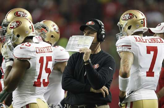 Quarterback Colin Kaepernick (7) and Wide receiver Michael Crabtree (15) with coach jim Harbaugh during the first half of the San Francisco 49ers game against the Atlanta Falcons in the NFC Championship game at the Georgia Dome in Atlanta, GA., on Sunday January 20, 2013. Photo: Michael Macor, The Chronicle