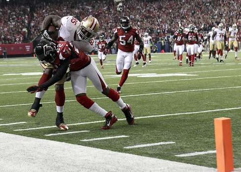 Tight end Vernon Davis (85) is pushed out of bonds by Atlanta Falcons linebacker Akeem Dent (52) during the second quarter of the San Francisco 49ers game against the Atlanta Falcons in the NFC Championship game at the Georgia Dome in Atlanta, GA., on Sunday January 20, 2013. Photo: Carlos Avila Gonzalez, The Chronicle