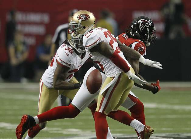 Cornerback Chris Culliver (29) and Safety Dashon Goldson (38) break up a pass in the first quarter of the San Francisco 49ers game against the Atlanta Falcons in the NFC Championship game at the Georgia Dome in Atlanta, GA., on Sunday January 20, 2013. Photo: Brant Ward, The Chronicle